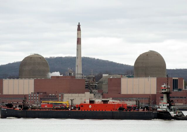 A barge passes by in front of Indian Point Nuclear Power Plant on the Hudson River March 22, 2011 in Buchanan, NY