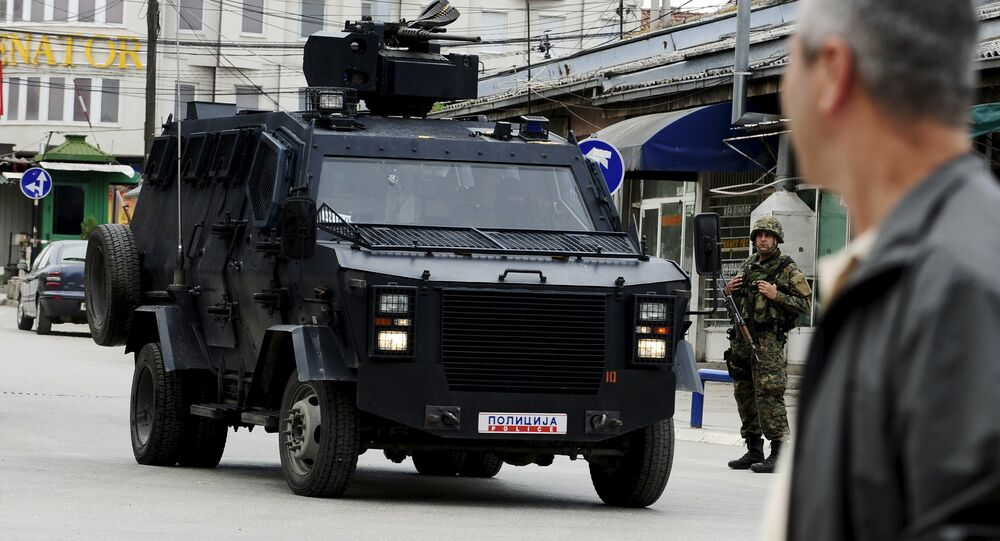 A Macedonian police armoured personnel carrier drives past premises in Kumanovo, north of the capital Skopje, Macedonia May 9, 2015