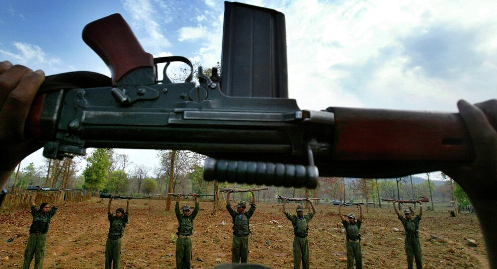 In this file photo, Naxalites, officially the Communist Party of India (Maoist) raise their arms during an exercise at a temporary base in the Abujh Marh forests, in the central Indian state of Chhattisgarh.