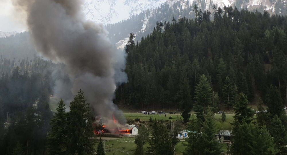 Flame and smoke rises from the site where a Pakistani military helicopter crashed in the northern area of Gilgit on May 8, 2015
