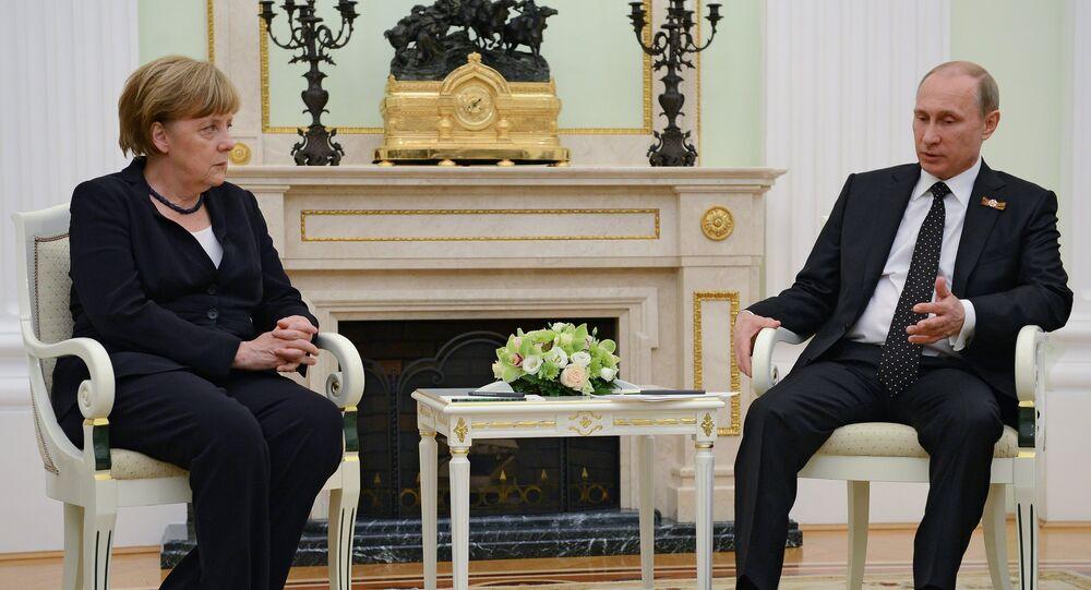 Russian President Vladimir Putin and German Chancellor Angela Merkel during meeting in the Kremlin on May 9, 2015