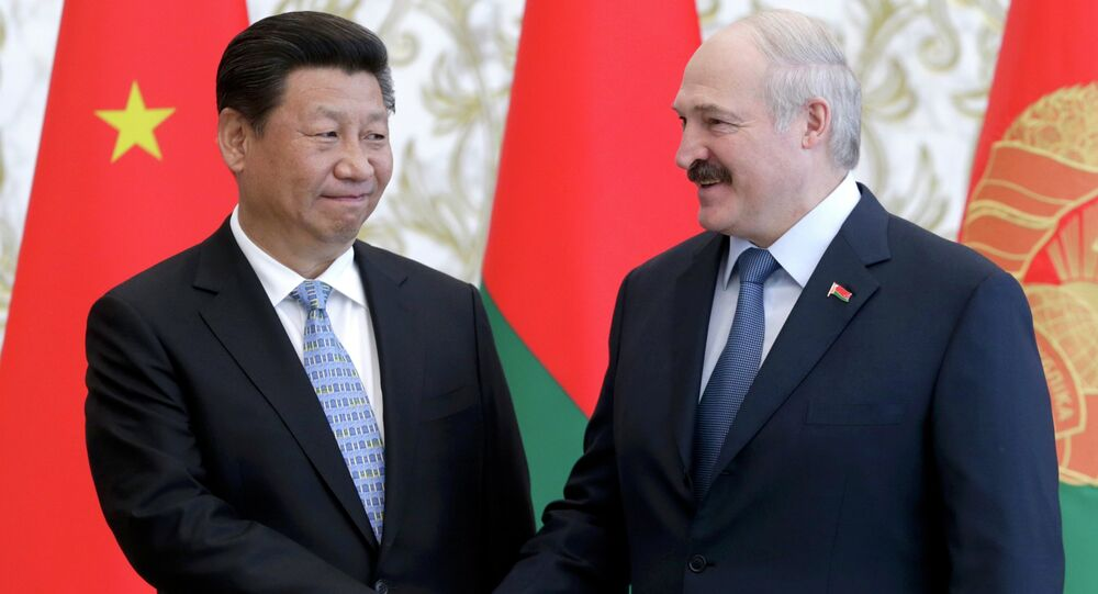 Belarussian President Alexander Lukashenko (R) shakes hands with his Chinese counterpart Xi Jinping during a meeting in Minsk, May 10, 2015