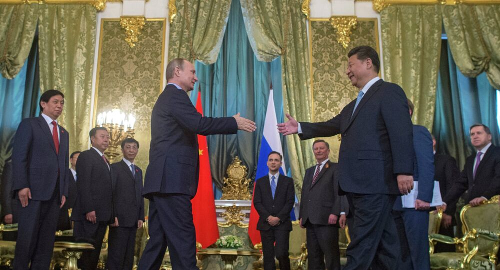 President Vladimir Putin meets with Chinese President Xi Jinping