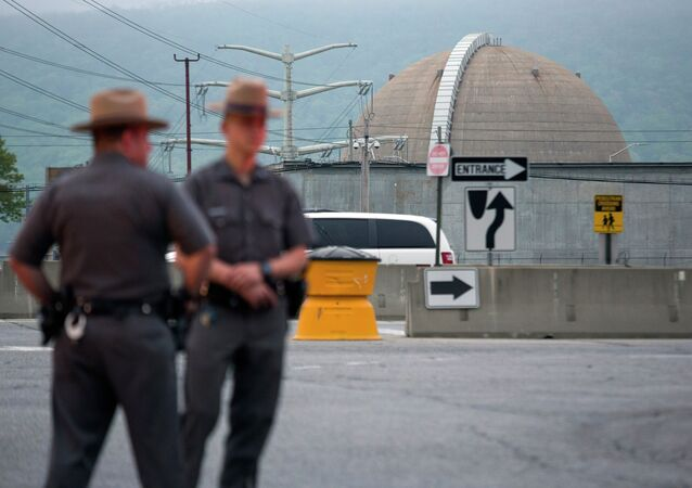 New York State Troopers stand at the main entrance of the Indian Point nuclear power plant Saturday May 9, 2015
