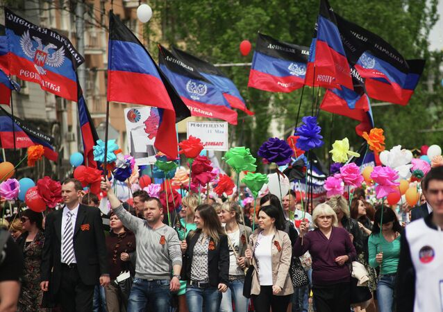 Supporters of the self-proclaimed Donetsk People's Republic attend a rally in Donetsk on May 11, 2015 to mark the first anniversary of independence referendums.