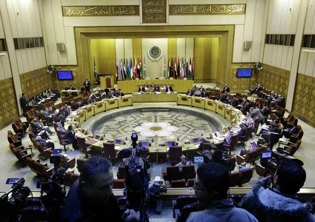 Representatives of the Arab League attend an emergency meeting to discuss the conflict in Libya, at the Arab League headquarters in Cairo, Egypt, Monday, Jan. 5, 2015.