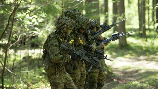 Estonian soldiers take part in an annual military exercise together with several units from other NATO member states - Sputnik International