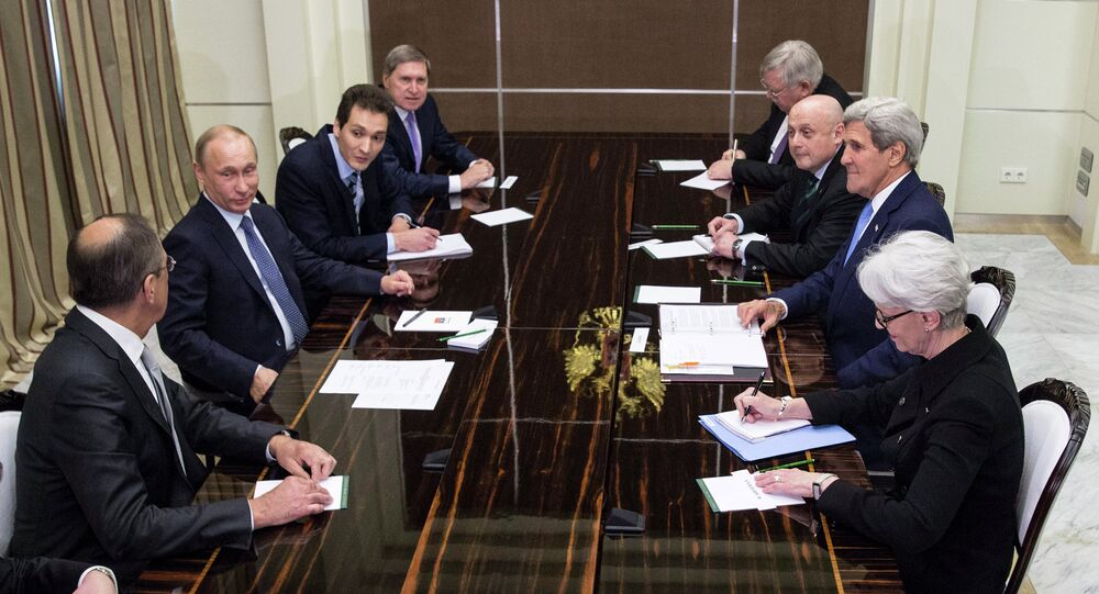 US Secretary of State John Kerry (2nd R) meets with Russia's President Vladimir Putin (2nd L) at the presidential residence Bocharov Ruchey in Sochi