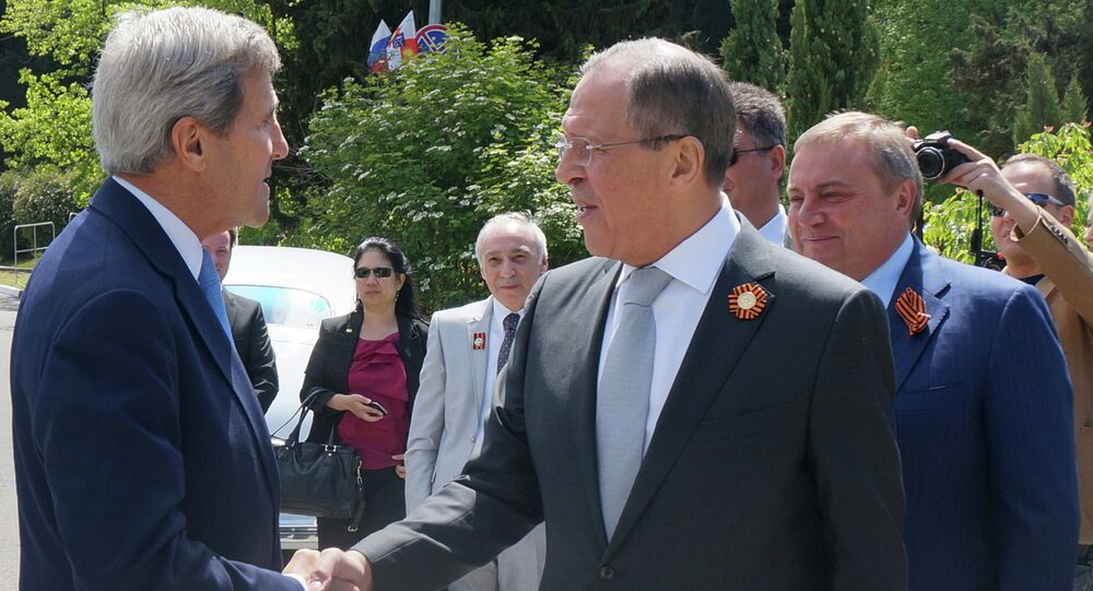 Foreground from right: Russian Foreign Minister Sergey Lavrov meets with US Secretary of State John Kerry
