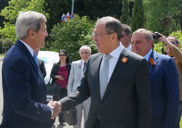 Foreground from right: Russian Foreign Minister Sergey Lavrov meets with US Secretary of State John Kerry in Sochi