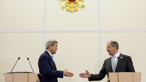 U.S. Secretary of State John Kerry shakes hands with Russian Foreign Secretary Sergey Lavrov after a news conference at the presidential residence of Bocharov Ruchey in Sochi, Russia May 12, 2015 - Sputnik International