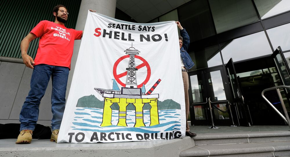 Protesters hold a sign opposing Shell Oil's plan to drill for oil in Arctic waters outside a meeting in Seattle of the Port of Seattle Commission to address the status of a Port lease with Foss Maritime, Tuesday, May 12, 2015, in Seattle