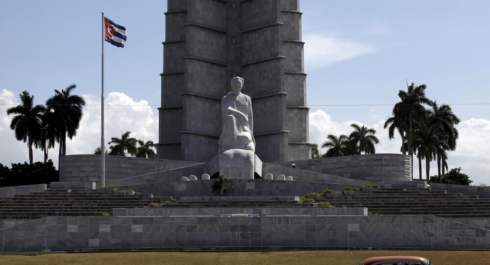 A car drives past the memorial monument of Cuban Independence hero Jose Marti in Havana's Revolution Square