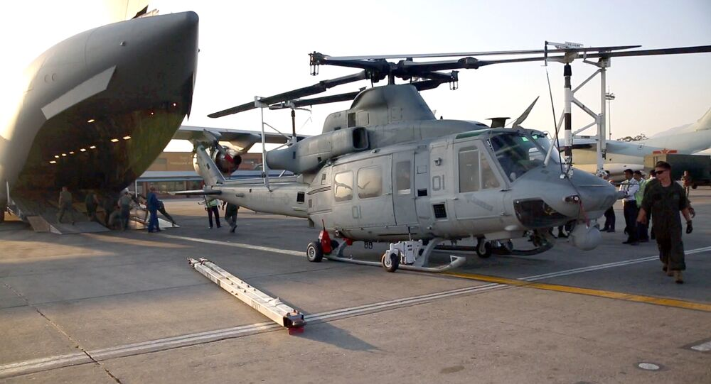 This May 3, 2015 US Marine Corps handout photo shows Marines unloading a UH-1Y Huey off of a Boeing C-17 Globemaster III at Tribhuvan International Airport in Kathmandu, Nepal.