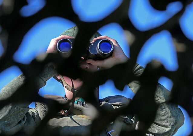 Russian soldier looking through binoculars during military exercise in the Kaliningrad Region. File photo.