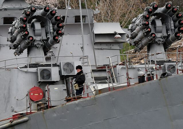 A Russian soldier stands on the Russian Black Sea Fleet Small Antisubmarine Warfare ship (ASW) Alexandrovets in the port of Sevastopol