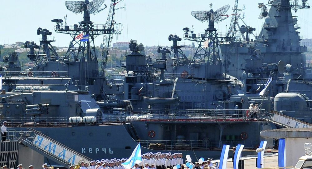 Russian sailors march near their Navy vessel in the bay of the Ukrainian city Sevastopol, the main base of the Russian Black Sea Fleet