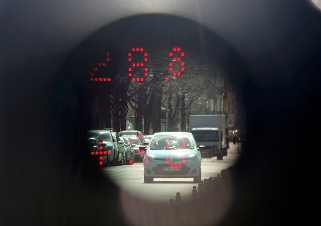 A car is pictured through the viewfinder of a police speed radar gun.