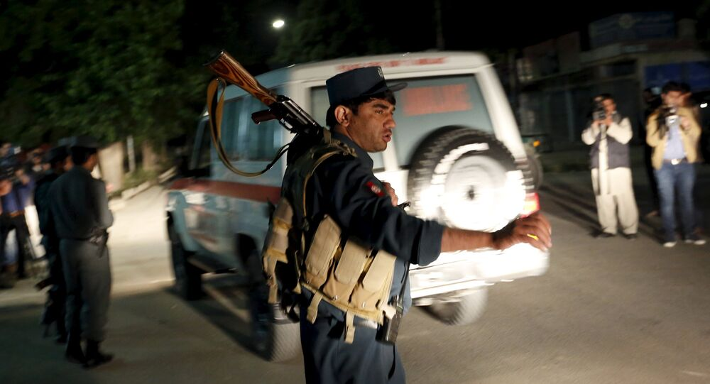 Afghan policeman stands guard at the site of an attack in Kabul, Afghanistan May 14, 2015