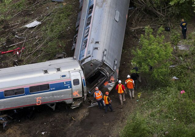 Emergency workers and Amtrak personnel inspect a derailed Amtrak train in Philadelphia, Pennsylvania May 13, 2015