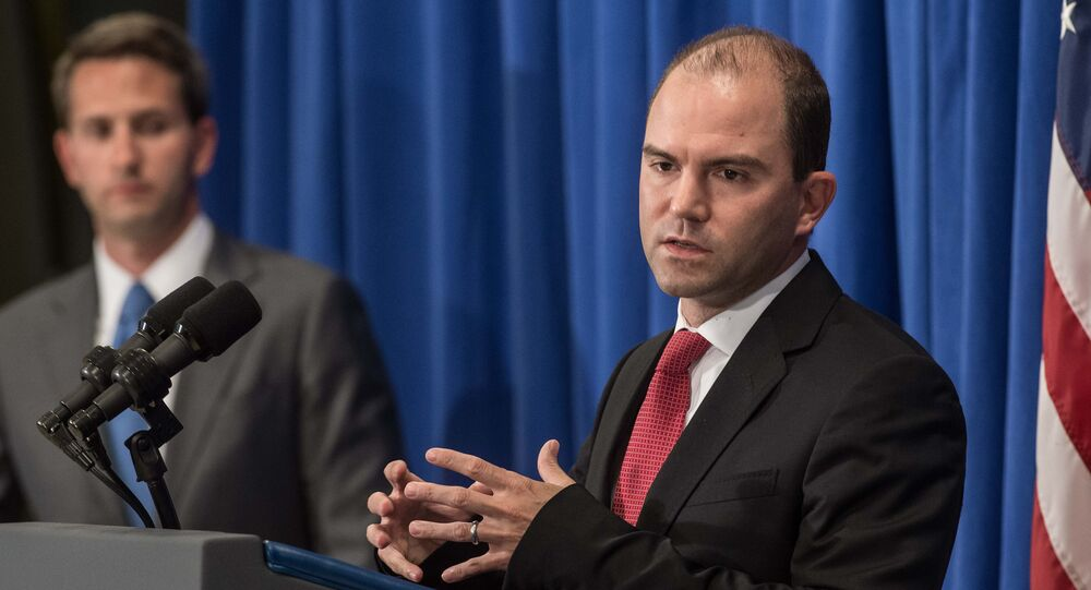 US Deputy National Security Adviser Ben Rhodes briefs the press as Principal Deputy Press Secretary Eric Schultz (L) looks on at Martha's Vineyard, Massachusetts, on August 22, 2014