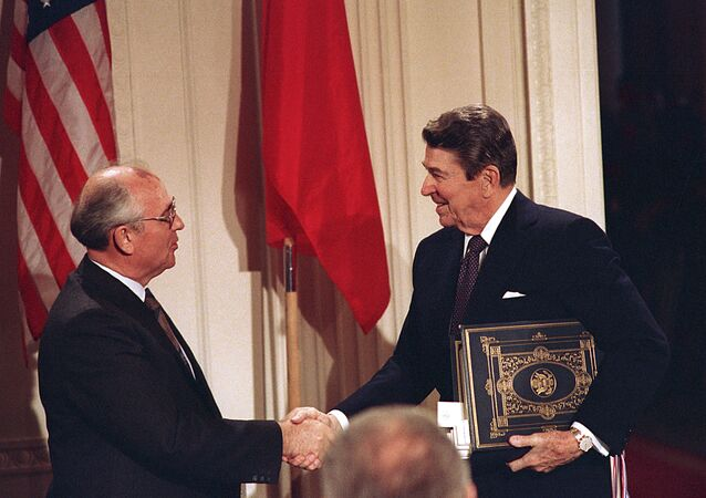 U.S. President Ronald Reagan, right, shakes hands with Soviet leader Mikhail Gorbachev after the two leaders signed the Intermediate Range Nuclear Forces Treaty to eliminate intermediate-range missiles during a ceremony in the White House East Room in Washington, D.C., in this Tuesday, Dec. 8, 1987 file photo