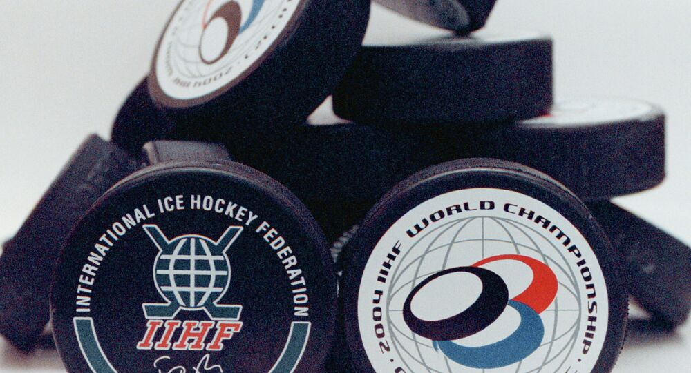 Official pucks to be used during the Ice Hockey World Championships 2004 are presented by the rubber-processing factory Gufex in Katerinice, Czech Republic