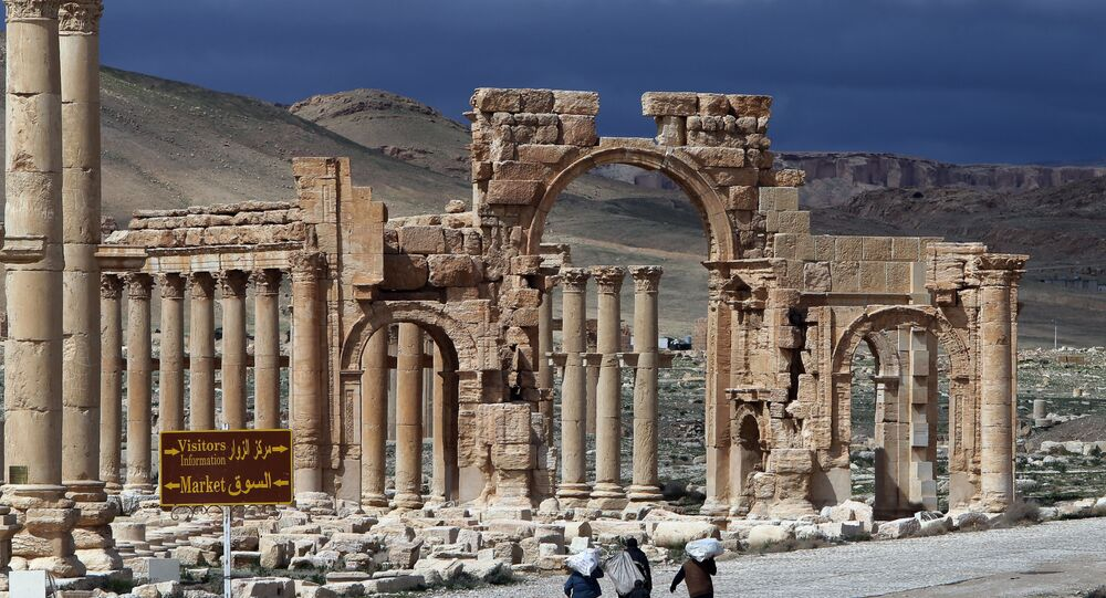 A file picture taken on March 14, 2014 shows Syrian citizens walking in the ancient oasis city of Palmyra, 215 kilometres northeast of Damascus. Islamic State (IS) group jihadists, who boast of having destroyed ancient sites in Iraq, threatened the ancient jewel of Palmyra, a UNESCO heritage site in the Syrian desert, on May 14, 2015