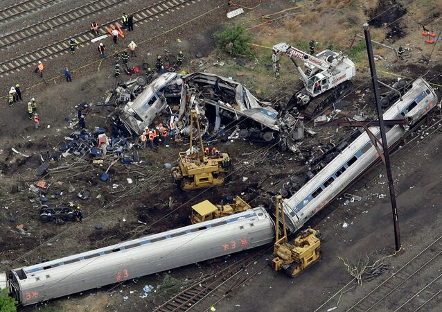 Emergency personnel work at the scene of a deadly train derailment, Wednesday, May 13, 2015, in Philadelphia