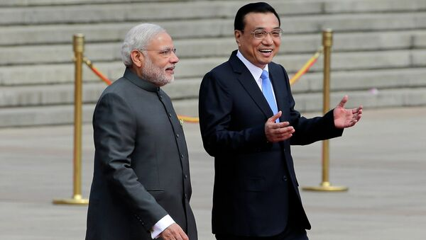 India's Prime Minister Narendra Modi, left, chats with Chinese Premier Li Keqiang during a welcome ceremony outside the Great Hall of the People in Beijing, China, Friday, May 15, 2015. - Sputnik International