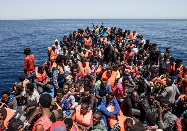 Migrants crowd the deck of their wooden boat off the coast of Libya May 14, 2015