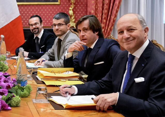 The director-general for political and security affairs at the French Foreign Ministry, Nicolas de Riviere (2nd R)