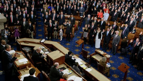 Speaker of the House John Boehner(L),R-OH, swears in members of the House during a ceremony in the House of Representatives as the 114th Congress convenes on Capitol Hill January 6, 2015 in Washington - Sputnik International