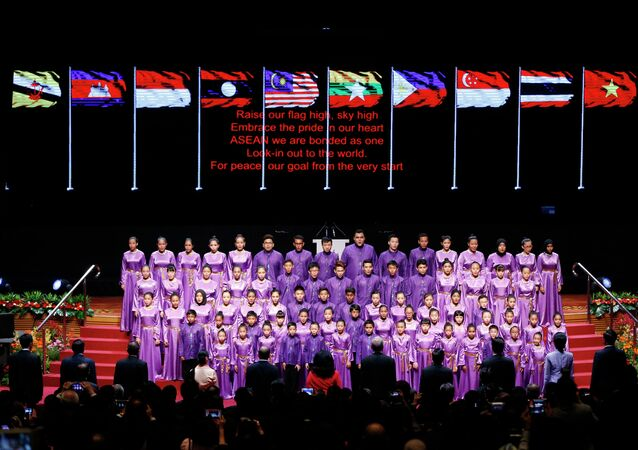 A student choir sing the anthem of the Association of Southeast Asian Nations (ASEAN) during the opening ceremony of the 26th ASEAN Summit in Kuala Lumpur, Malaysia, on Monday, April 27, 2015