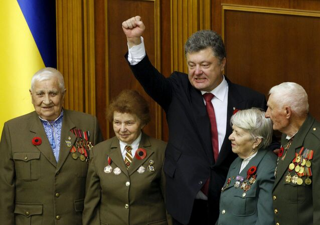 Ukrainian President Petro Poroshenko (center) gestures as he stands with veterans of the Ukrainian Insurgent Army (UPA) after a commemorative parliament session marking the 70th anniversary of the end of the war in Europe in Kiev, Ukraine May 8, 2015