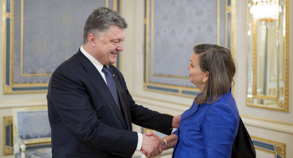 Ukrainian President Petro Poroshenko (L) greets U.S. Assistant Secretary of State for European and Eurasian Affairs Victoria Nuland during a meeting in Kiev, Ukraine, May 15, 2015