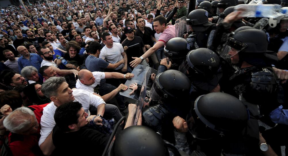 Protestors fight with police in front of the Macedonian government building in Skopje, Macedonia May 5, 2015