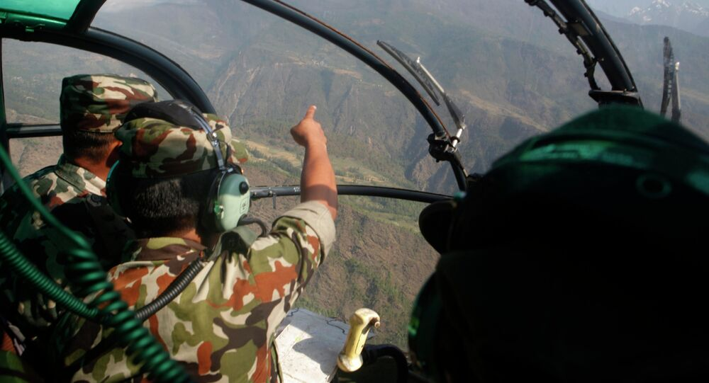 Nepalese army men search for the missing U.S. Marine helicopter in the earthquake affected Dolakha District, Nepal, Thursday, May 14, 2015