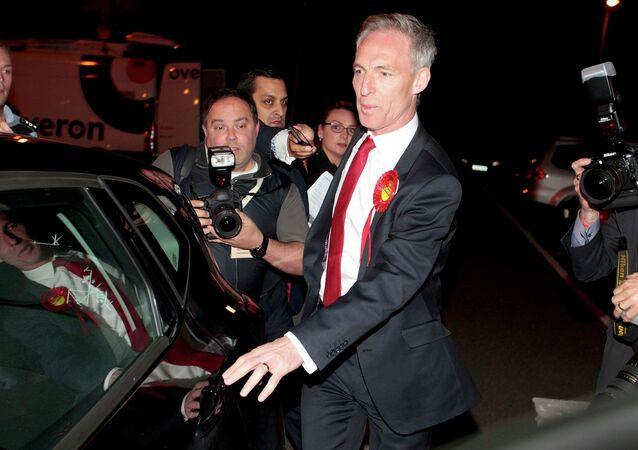 Scottish Labour Party leader Jim Murphy leaves the election count after failing to be re-elected as a member of parliament for East Renfrewshire in Scotland, Britain May 8, 2015