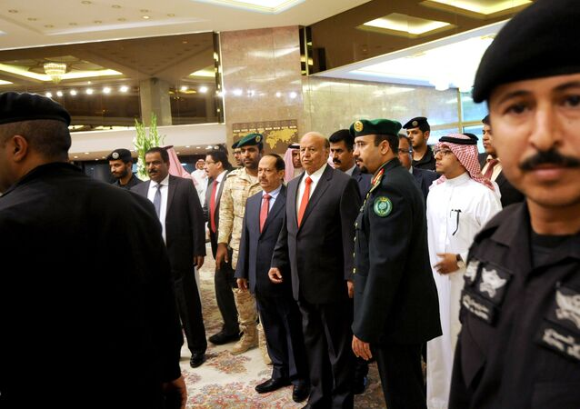 Yemen's exiled President Abed Rabbo Mansour Hadi (C) is seen surrounded by security forces upon his arrival for the opening of Riyadh Conference for Saving Yemen and Building Federal State in the Saudi capital Riyadh, on May 17, 2015