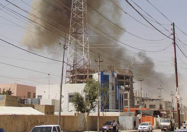 Smoke rises after a bomb attack in the city of Ramadi, May 15, 2015