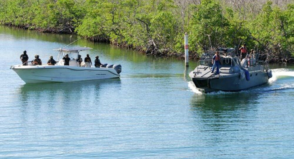 Mexican Navy fast boat, left, escorts a Mexican Navy patrol boat carrying illegal Cuban immigrants