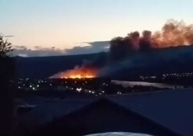 The growing fire is seen in a video posted on Facebook just after 8:00 p.m. May 17, 2015