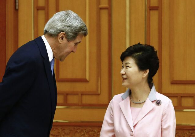 US Secretary of State John Kerry (L) speaks with South Korean President Park Geun-hye (R) prior to a meeting at the Blue House in Seoul on May 18, 2015