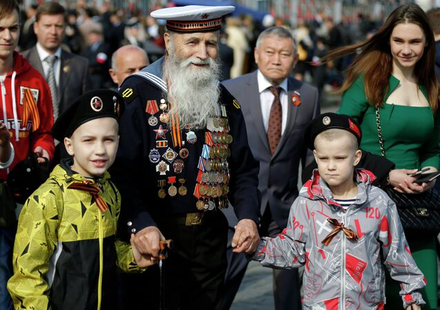 Georgy Shirokov, 91, a Russian veteran of WWII and former sailor of the Baltic Fleet walks in Red Square before the Victory Parade, celebrating 70 years after WWII, in Moscow, Russia, Saturday, May 9, 2015
