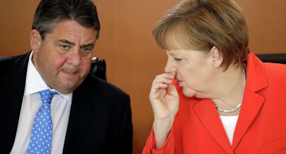 German Chancellor Angela Merkel, right, and Vice-Chancellor Sigmar Gabriel, left