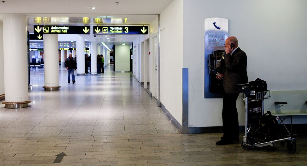A man makes a phone call in Copenhagen International Airport in Kastrup