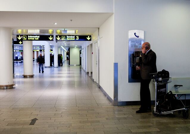 A man makes a phone call in Copenhagen International Airport in Kastrup