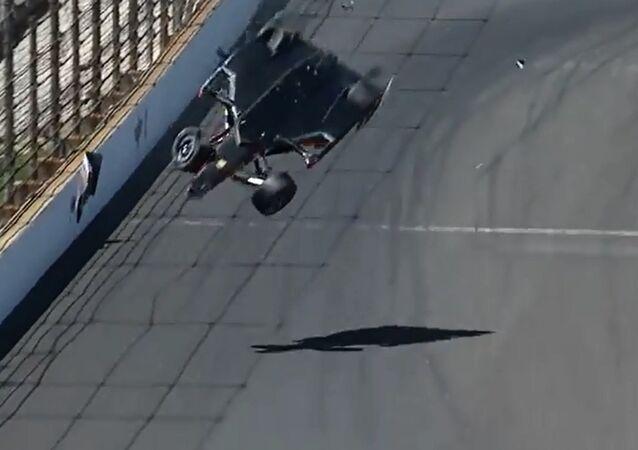 Car Flips Backwards Over Race Track