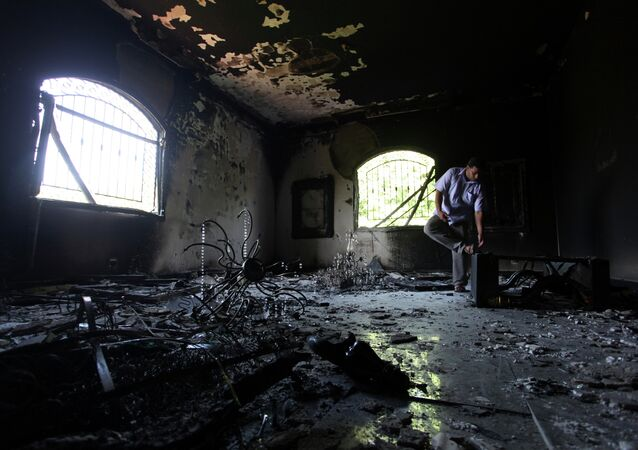 A Libyan man investigates the inside of the U.S. Consulate after an attack that killed four Americans.